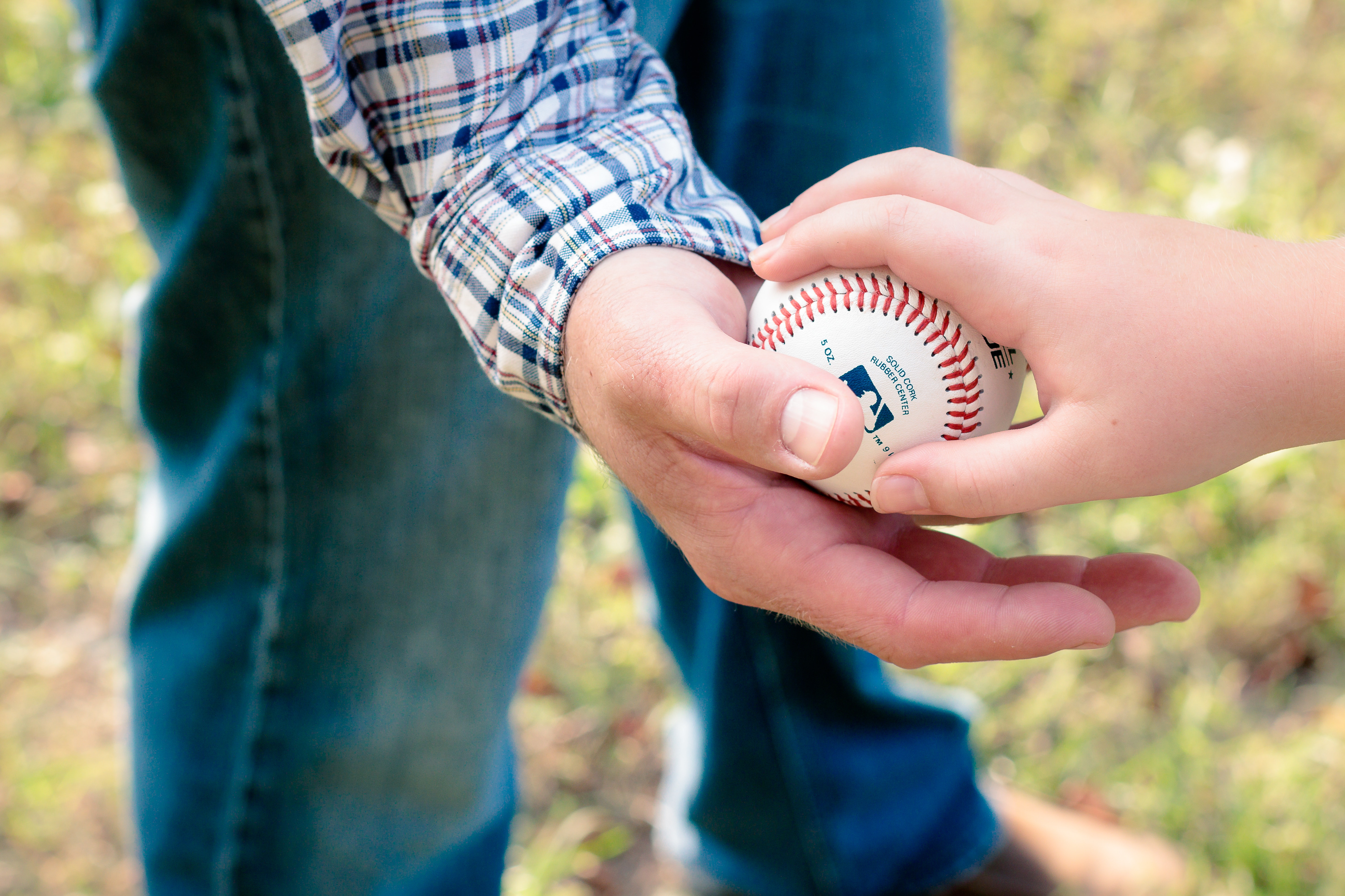 two-person-holding-white-baseball-ball-1481358